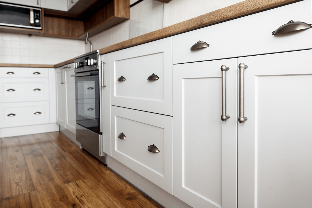 white kitchen cabinets - where to put things in kitchen cabinets